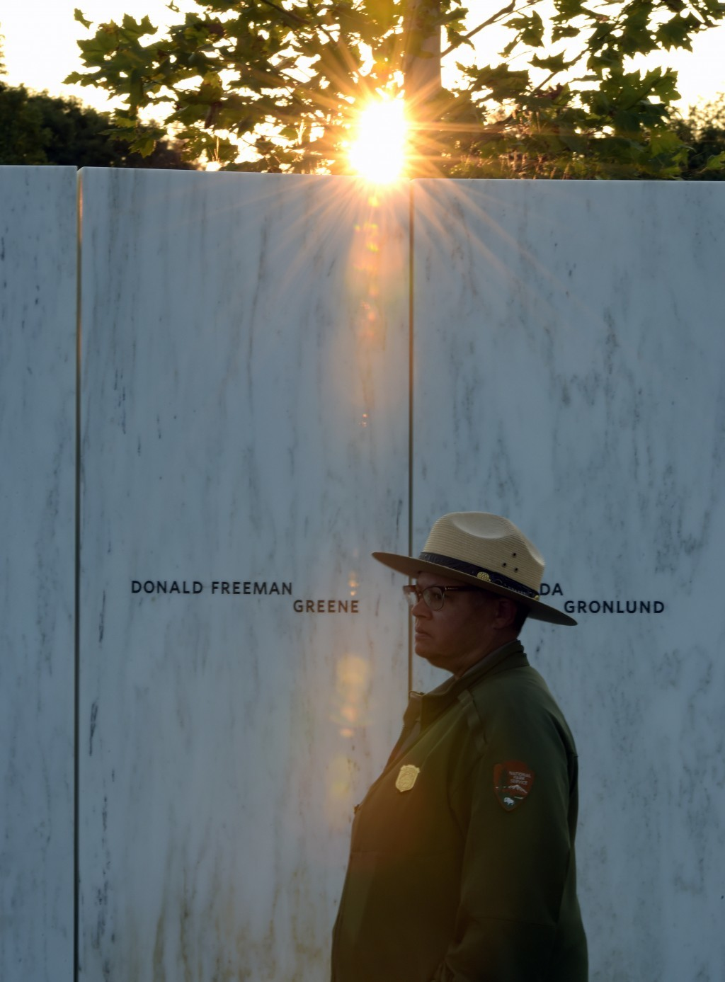 A park ranger stands in front of the Wall of Names at the United Flight 93 National Memorial in Shanksville, Pa., Saturday, Sept. 10, 2017. (AP Photo/...