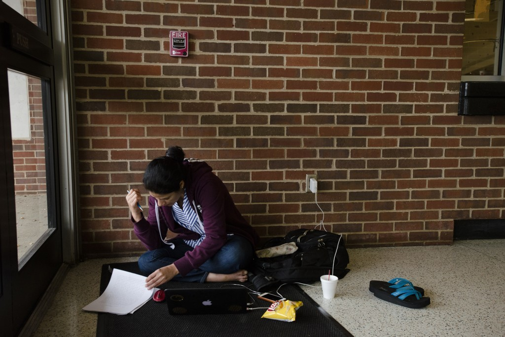 Maha Al-Tameemi, a student in Orlando from Iraq, works on her Ph.D. in Chemistry dissertation at the Red Cross Hurricane Irma Disaster Shelter in Mont...