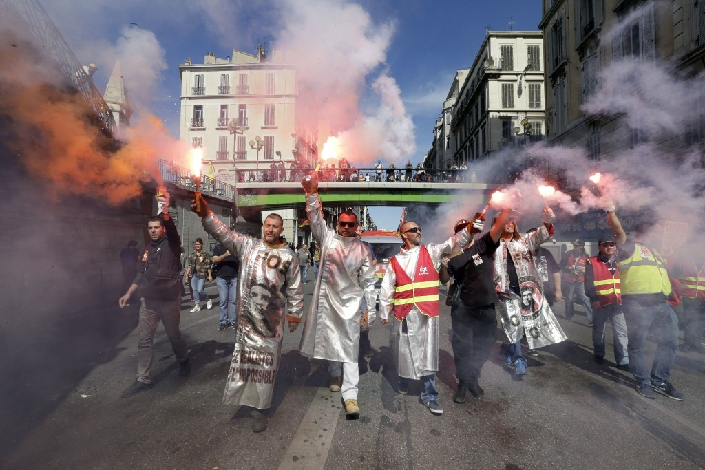 Steelworkers from the ArcelorMittal steel plant in Fos-sur-Mer burn flares during a nationwide day of protest against government labor law, in Marseil...