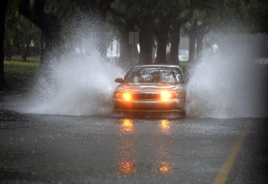 Rain from Tropical Storm Irma makes Victory Drive next to Daffin Park a water challenge to drivers Monday, Sept. 11, 2017, in Savannah, Ga. (Steve Bis...