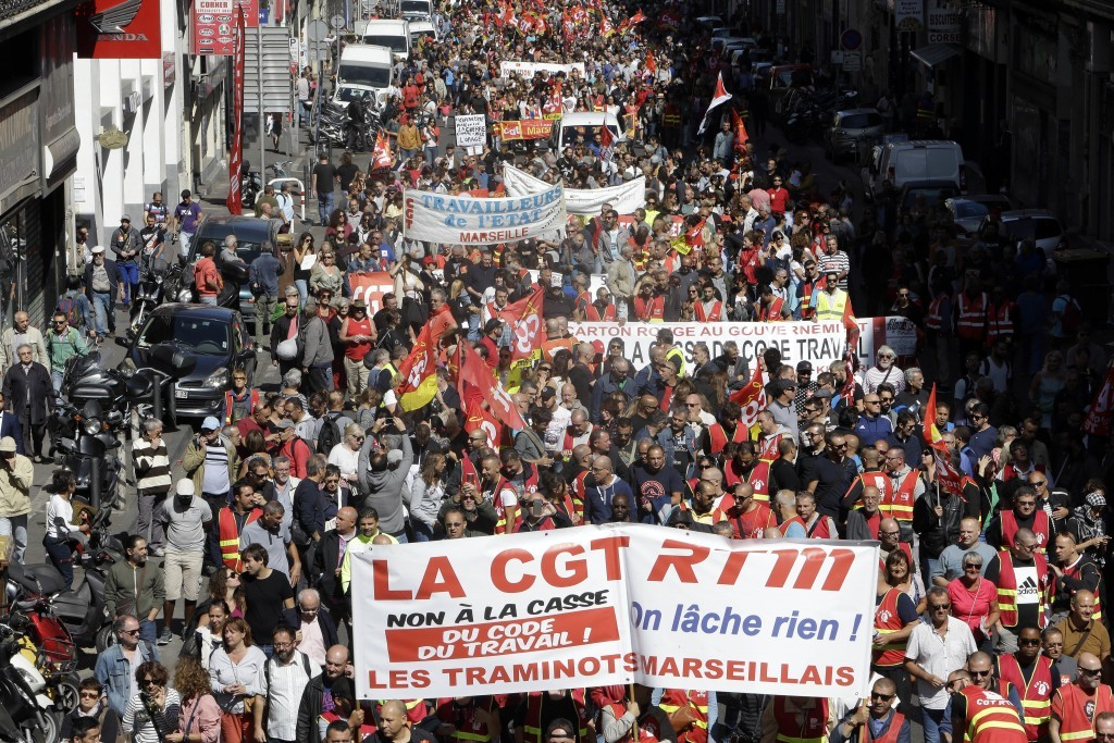 Workers demonstrate in Marseille, southern France, Tuesday, Sept. 12, 2017. President Emmanuel Macron's presidency is facing its first big public test...