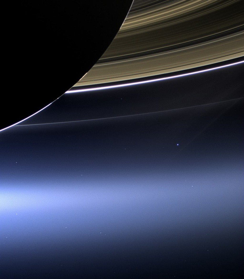 This July 19, 2013 image made available by NASA shows Saturn's rings and planet Earth, center right, as seen from the Cassini spacecraft. (NASA/JPL-Ca...