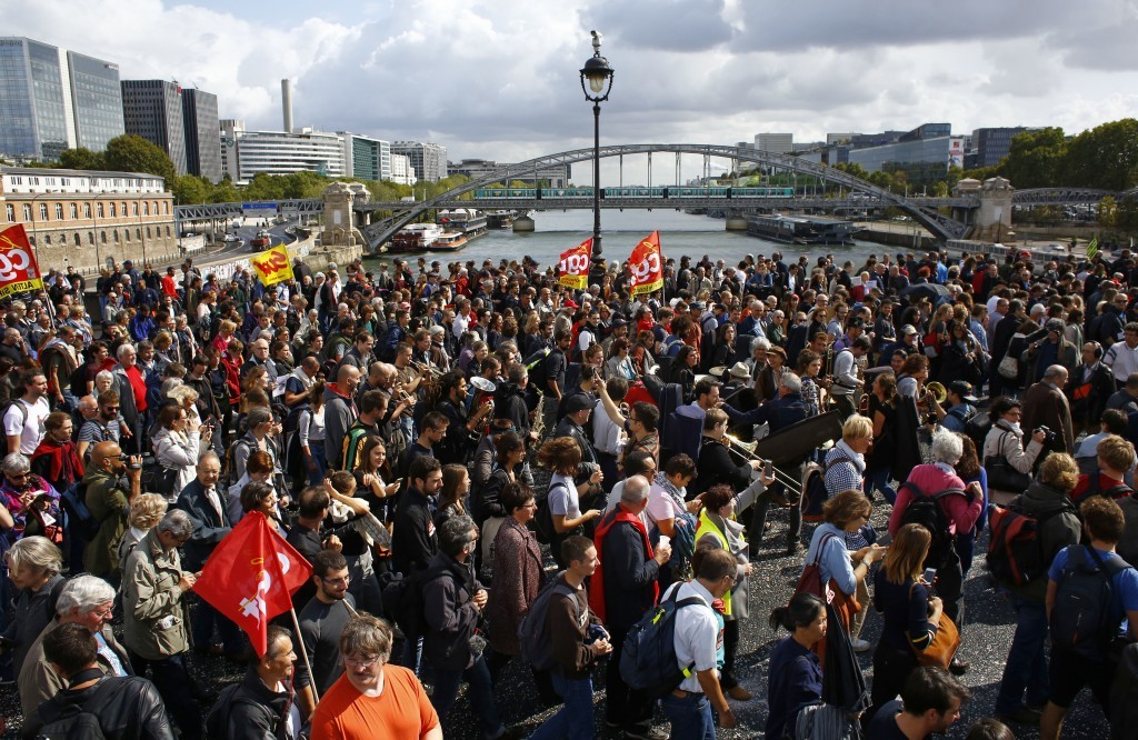 Protestors march against President Emmanuel Macron's new pro-business labor policies in Paris, Tuesday, Sept. 12, 2017. Macron's presidency is facing ...