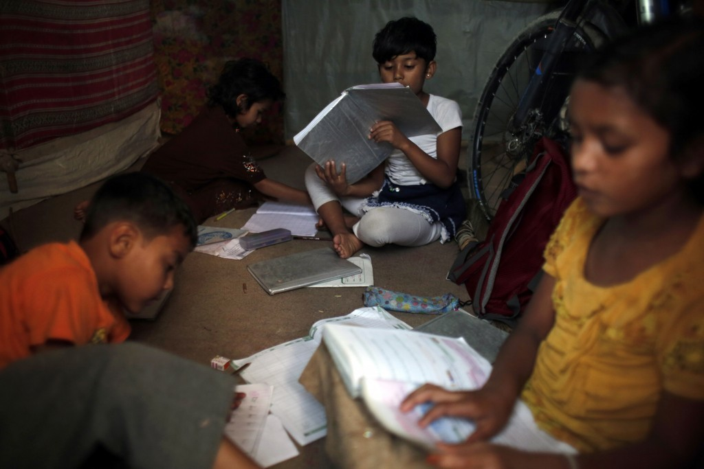 In this Sunday, Sept. 10, 2017, photo, Rohingya children study inside a temporary shelter at a camp in Kathmandu, Nepal. Recent violence in Myanmar ha...