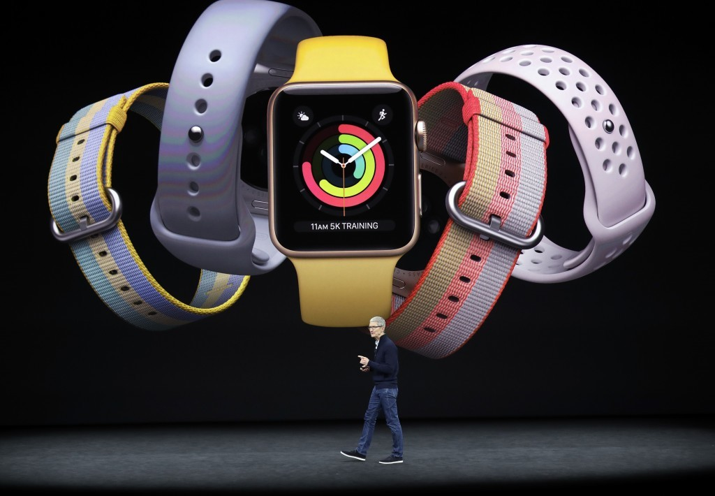 Apple CEO Tim Cook shows new products at the Steve Jobs Theater on the new Apple campus on Tuesday, Sept. 12, 2017, in Cupertino, Calif. (AP Photo/Mar...