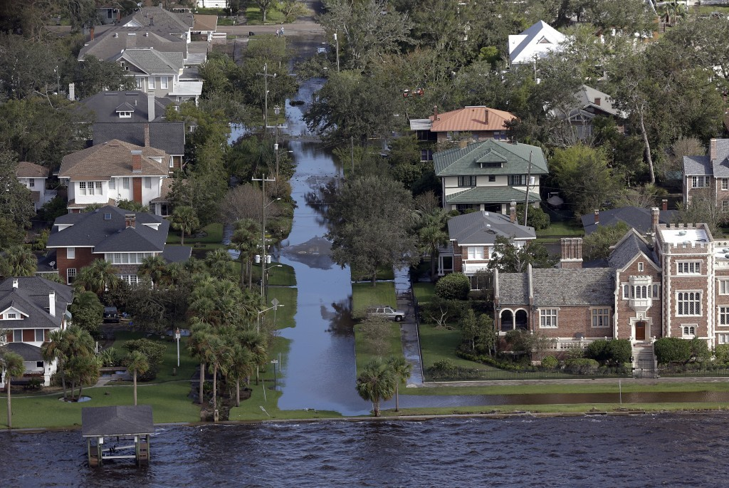 A few streets remain flooded along the St. John's River in Jacksonville, Fla., in the aftermath of Hurricane Irma, Tuesday, Sept. 12, 2017. (AP Photo/...
