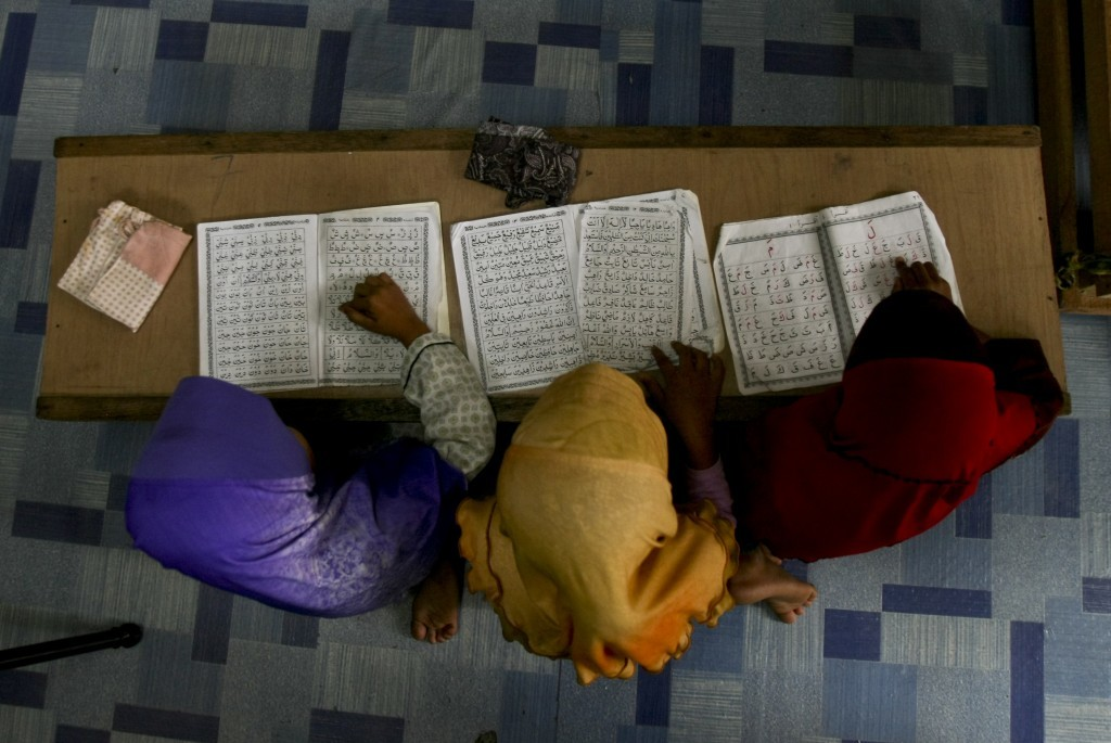 In this Tuesday, Sept. 12, 2017, photo, Rohingya Muslim children living in Malaysia recite from the holy Quran at a school in Klang, on the outskirts ...