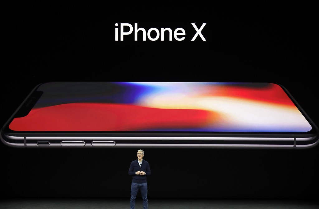 Apple CEO Tim Cook announces the new iPhone X at the Steve Jobs Theater on the new Apple campus, Tuesday, Sept. 12, 2017, in Cupertino, Calif. (AP Pho...