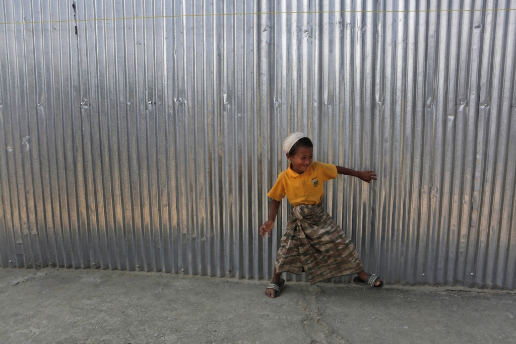 In this Sunday, Sept. 10, 2017, photo, a Rohingya boy plays outside a temporary shelter at a camp in Kathmandu, Nepal. Recent violence in Myanmar has ...