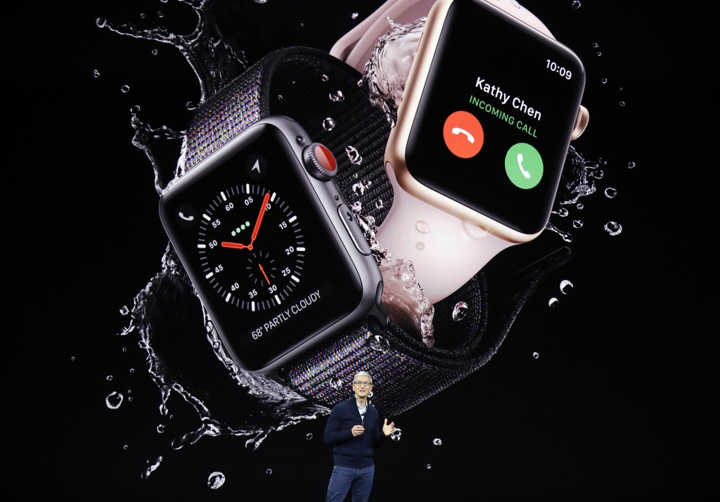 Apple CEO Tim Cook shows new Apple Watch Series 3 products at the Steve Jobs Theater on the new Apple campus, Tuesday, Sept. 12, 2017, in Cupertino, C...