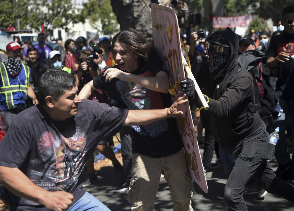 FILE - In this Aug. 27, 2017 file photo, demonstrators clash during a free speech rally in Berkeley, Calif. Police in Berkeley, California say they ne...