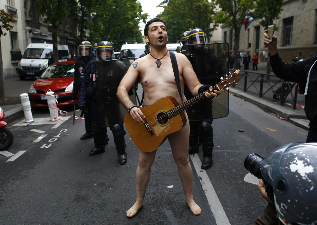 A naked demonstrator sings during a protest march against President Emmanuel Macron's new pro-business labor policies in Paris, Tuesday, Sept. 12, 201...