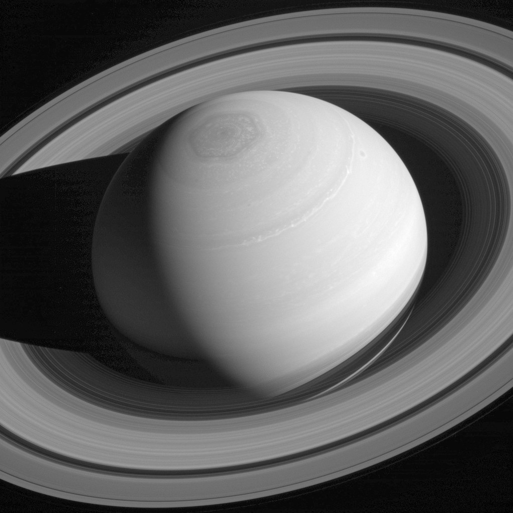 This May 4, 2014 image made available by NASA shows the persistent hexagonal cloud pattern on Saturn's north pole, as seen from the Cassini spacecraft...