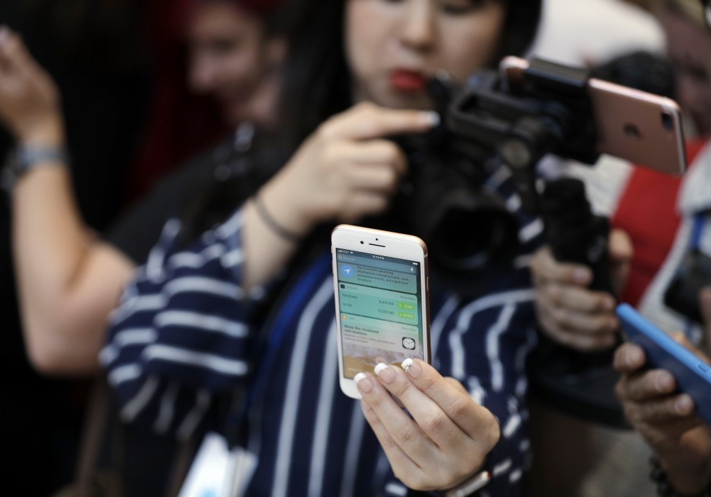 The new iPhone 8 Plus is displayed in the showroom after the new product announcement at the Steve Jobs Theater on the new Apple campus on Tuesday, Se...