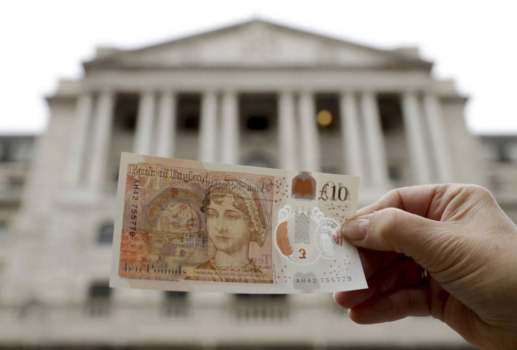One of the new British 10 pound notes is posed for photographs outside the Bank of England in the City of London, Thursday, Sept. 14, 2017. The new po...