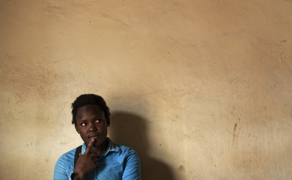 In this Wednesday, May 31, 2017 photo, Asimart Nakabanda, 15, whose child marriage was foiled at the planned wedding ceremony in a surprise raid by po...