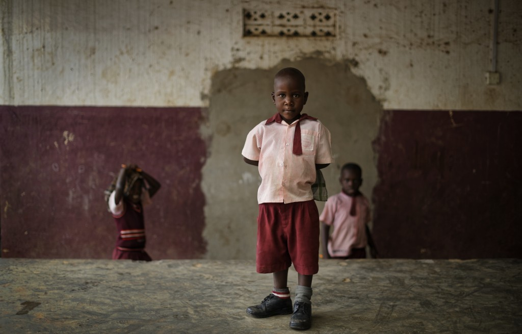 In this Tuesday, May 30, 2017 photo, Keron Sembuya, who teachers believe to be around 4 or 5 years old, stands for a photograph at the Mpugwe Parents ...