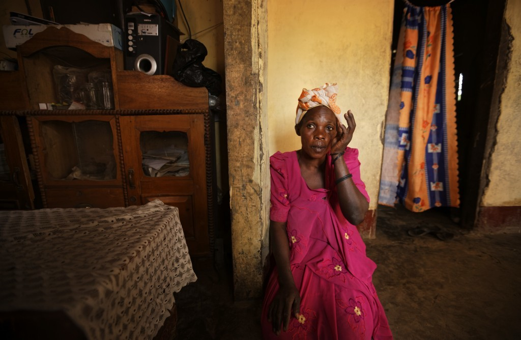 In this Wednesday, May 31, 2017 photo, Madina Nansubuga, the mother of Asimart Nakabanda, 15, whose child marriage was foiled at the planned wedding c...