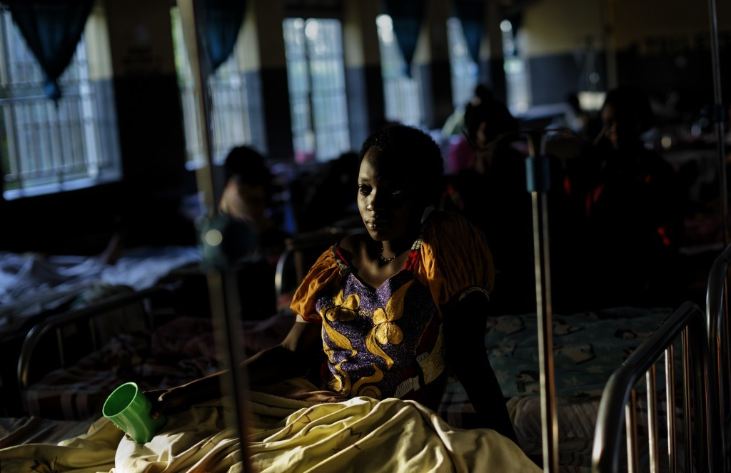 In this Wednesday, May 31, 2017 photo, expectant mothers lie on beds in the maternity ward of the Kalisizo General Hospital in Kalisizo, Uganda. The b...