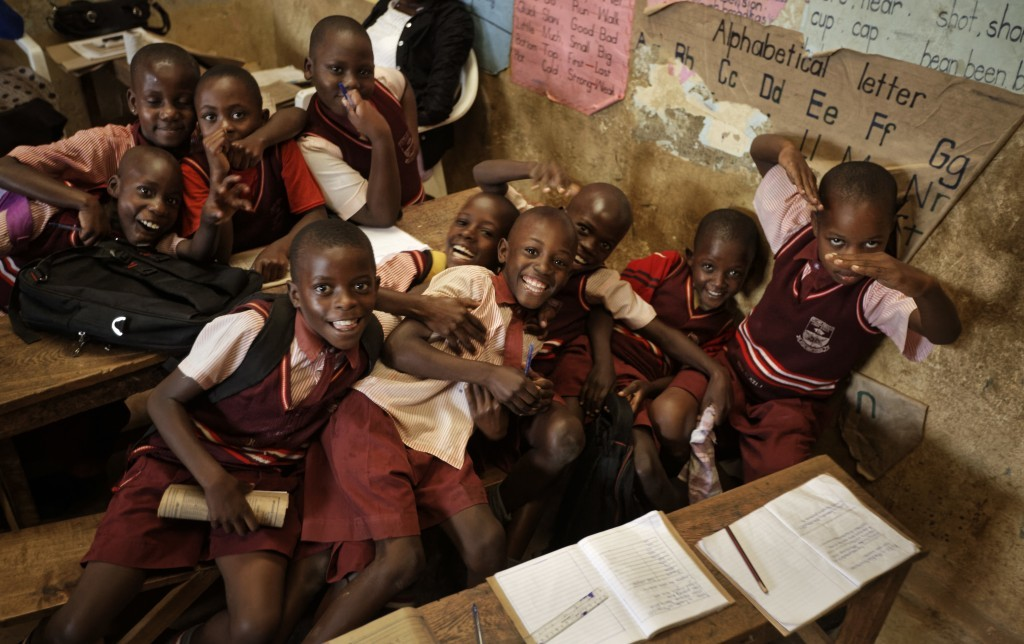 In this Tuesday, May 30, 2017 photo, school children play for the camera during a class at the Mpugwe Parents Junior School in Masaka, Uganda. The bir...