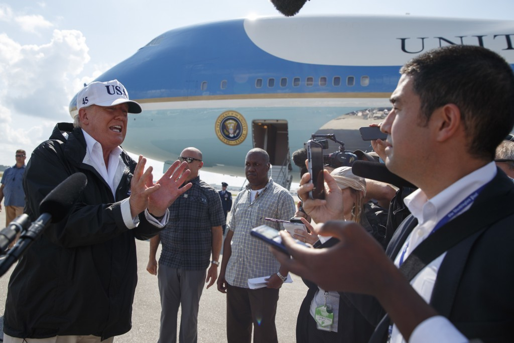 FILE - In this Thursday, Sept. 14, 2017, file photo, President Donald Trump talks with reporters after landing on Air Force One, in Fort Myers, Fla. T