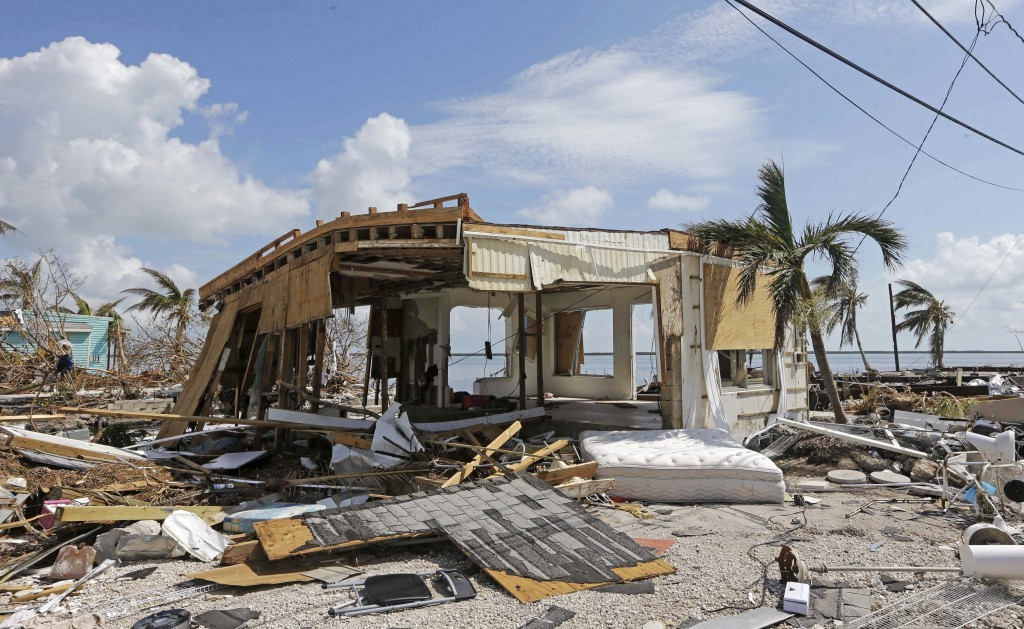 In this Sept. 13, 2017, photo, debris surrounds a destroyed structure in the aftermath of Hurricane Irma in Big Pine Key, Fla. Rising sea levels and f...