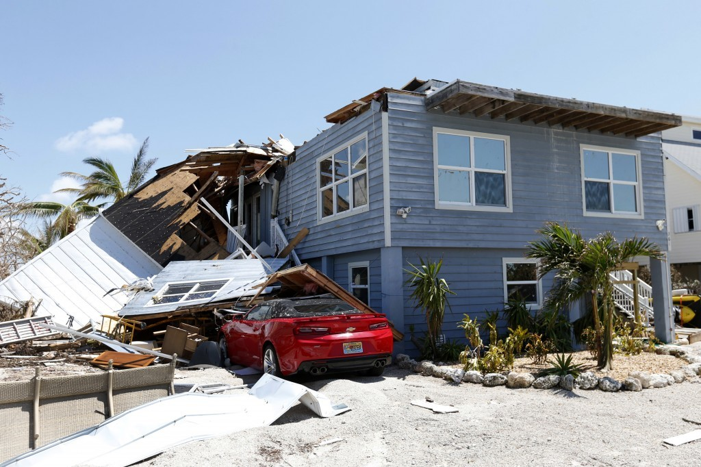 In this Sept. 13, 2017, photo, a house with its roof blown off by Hurricane Irma in Summerland Key, in the Florida Keys. Rising sea levels and fierce ...