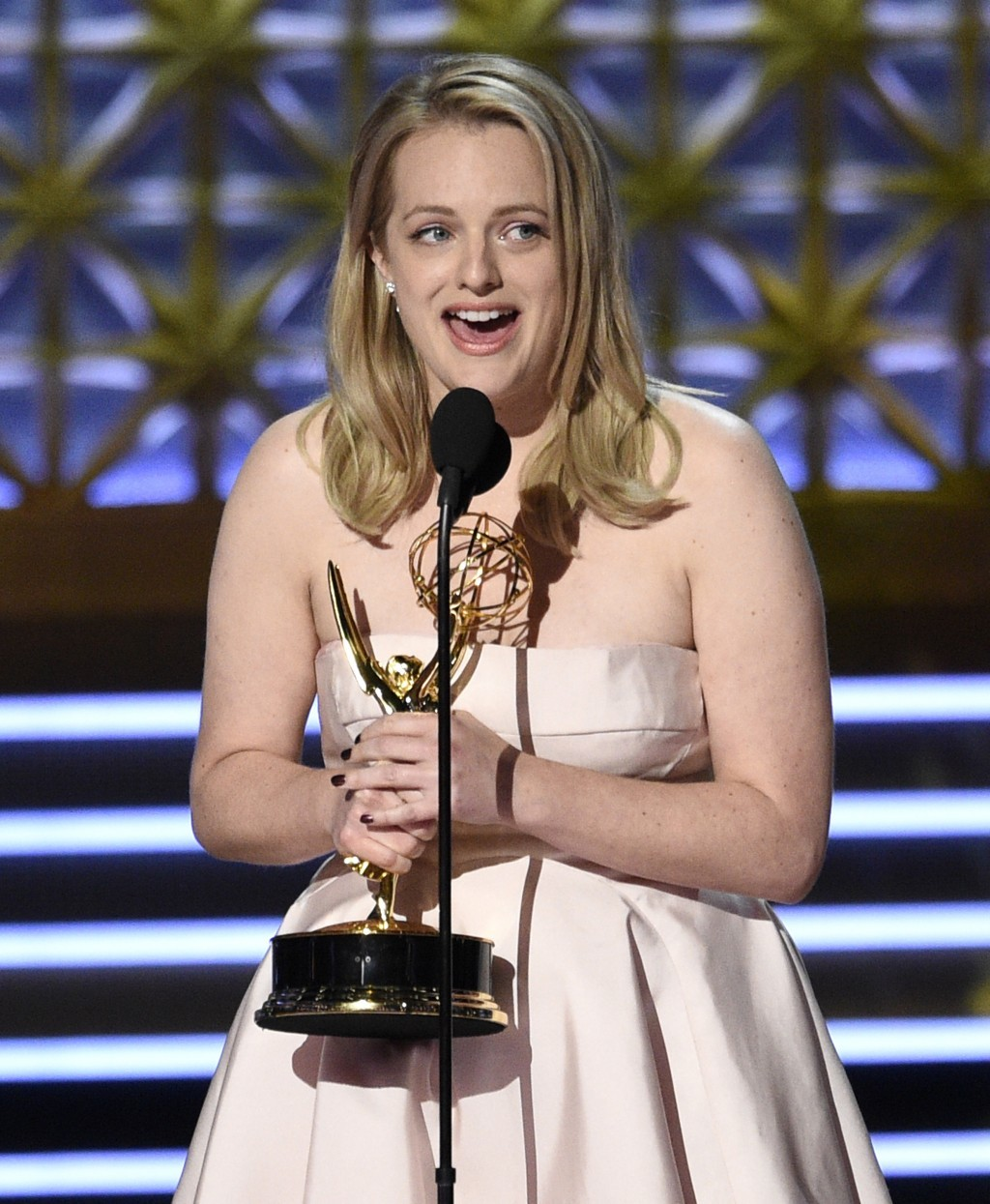 "Elisabeth Moss accepts the award for outstanding lead actress in a drama series for ""The Handmaid's Tale"" at the 69th Primetime Emmy Awards on Sunday,..."