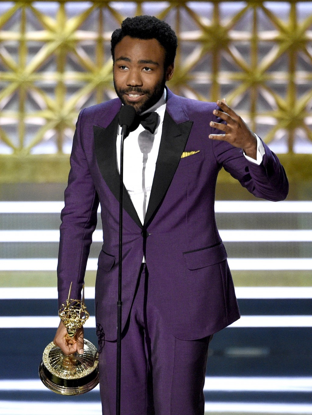 "Donald Glover accepts the award for outstanding directing for a comedy series for the ""Atlanta"" episode ""B.A.N."" at the 69th Primetime Emmy Awards on ..."