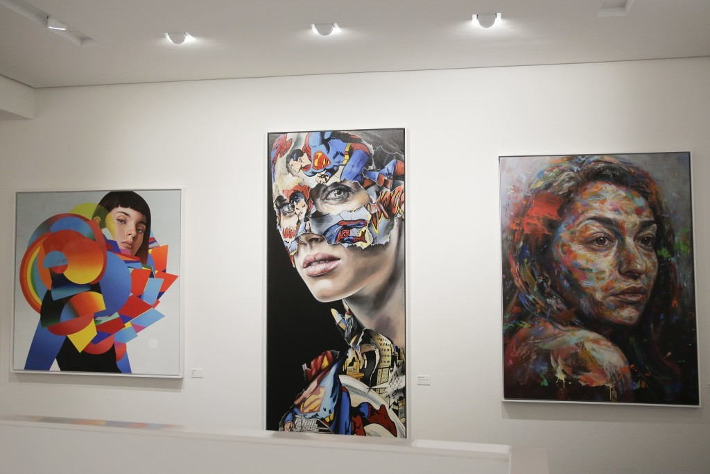 """The paintings, from left, 'Dropper"""" by Eric Jones, 'La Cage Entre Victoire Et Defaite' by Sandra Chevrier and 'The Distance Between Is Equal' by David"""