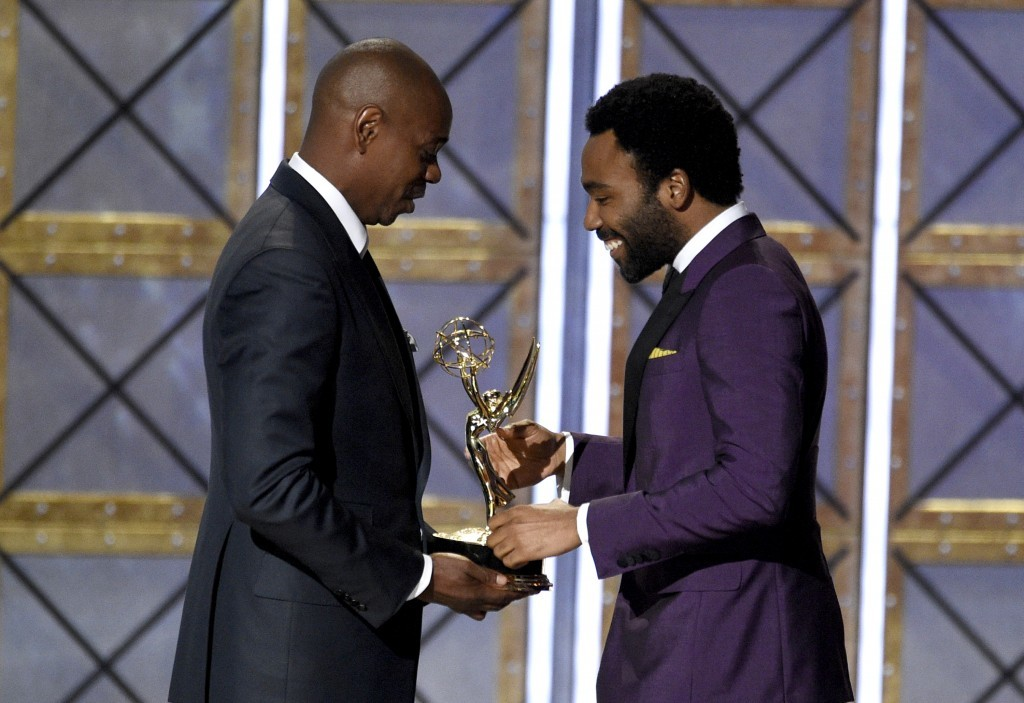 "Dave Chappelle, left, presents the award for outstanding directing for a comedy series for the ""Atlanta"" episode ""B.A.N."" to Donald Glover at the 69th..."