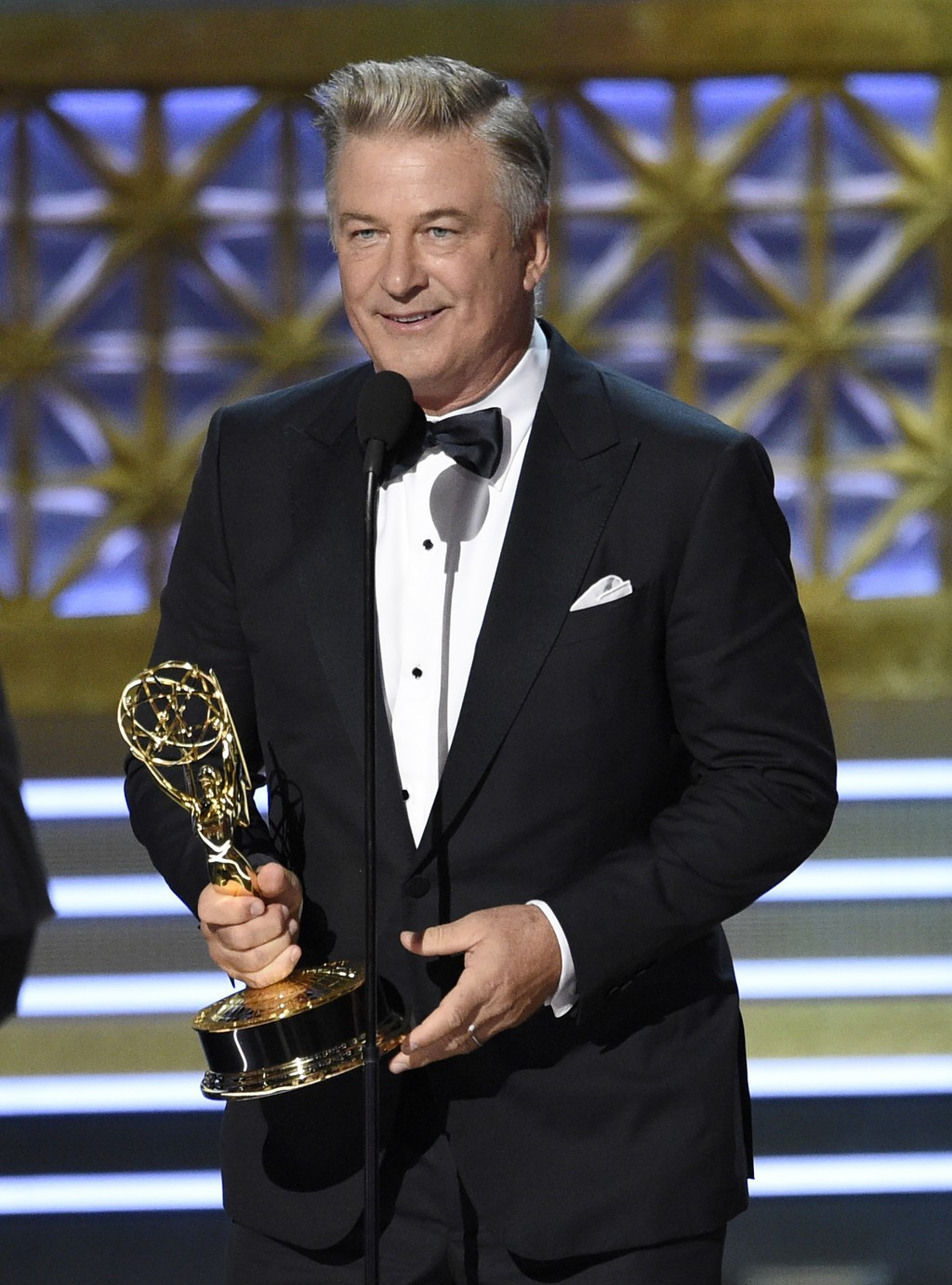 "Alec Baldwin accepts the award for outstanding supporting actor in a comedy series for ""Saturday Night Live"" at the 69th Primetime Emmy Awards on Sund..."