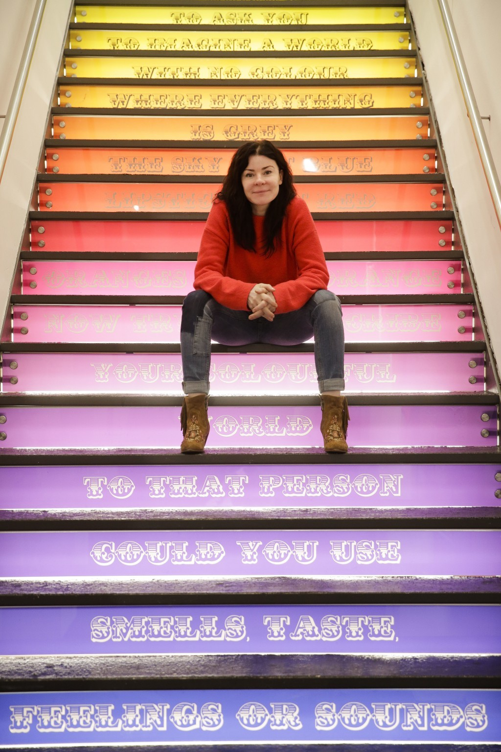 The director of the new Urban Nation Museum for Urban Contemporary Art, Yasha Young poses on stairs inside the exhibition in Berlin, Germany, Monday,