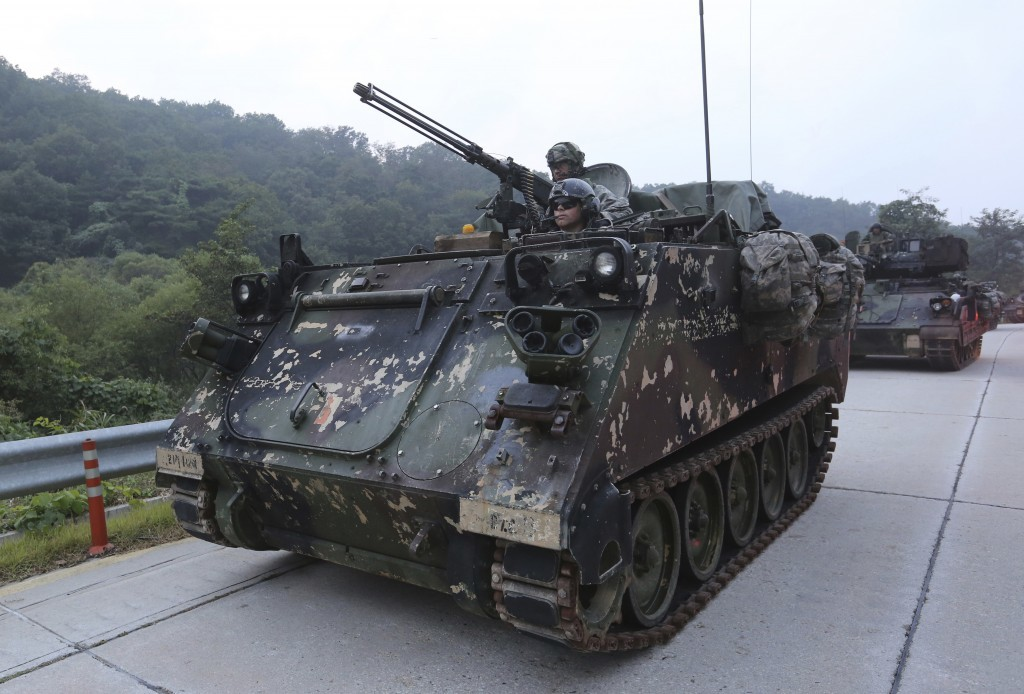 U.S. Army armored vehicles from the 2nd Infantry Division's the 2nd Armored Brigade Combat Team move during a joint military exercise between the U.S....