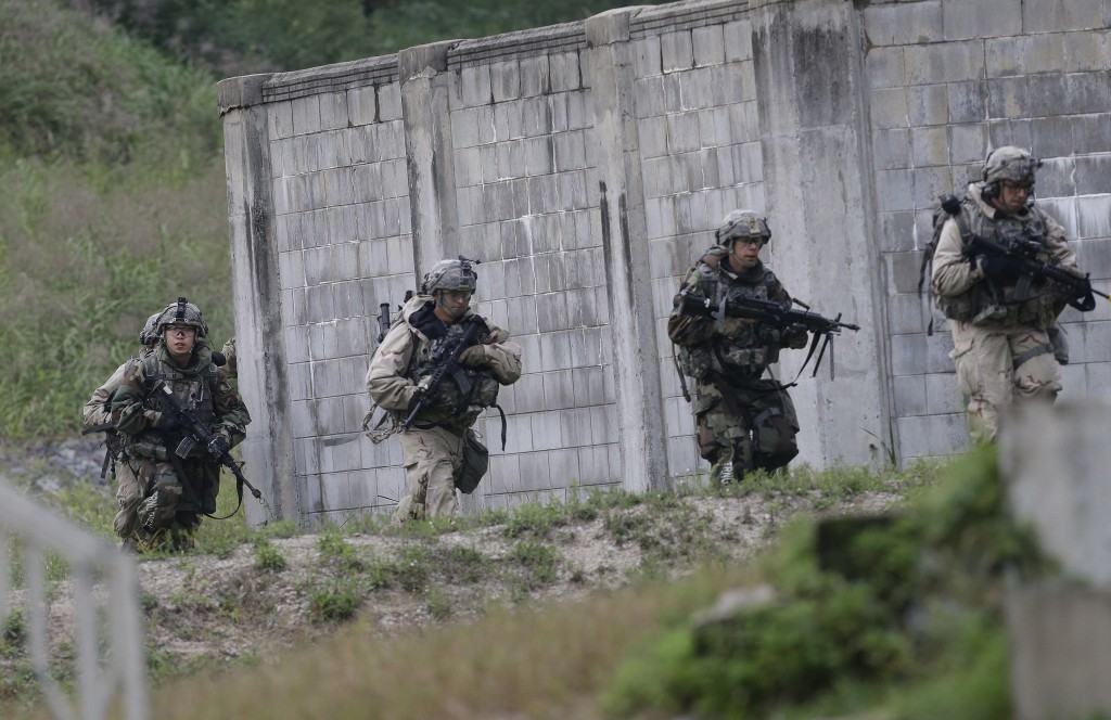 U.S. Army soldiers from the 2nd Infantry Division's the 2nd Armored Brigade Combat Team move during a joint military exercise between the U.S. and Sou...