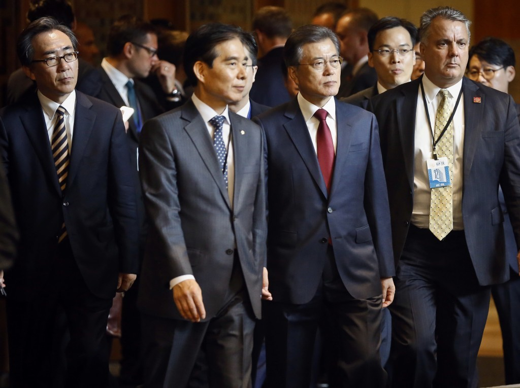 South Korea's President Moon Jae-in, second from right, arrives for the meeting of the United Nations General Assembly, Tuesday Sept. 19, 2017, at U.N...