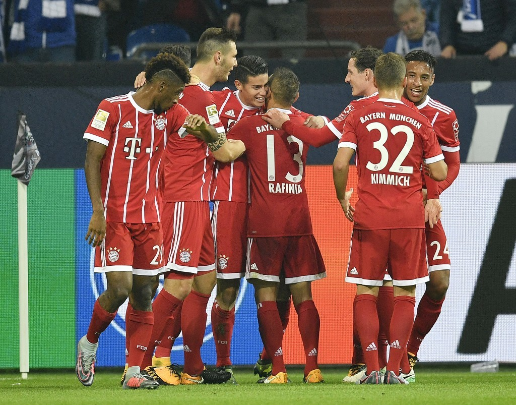 Bayern's James Rodriguez is celebrated by his team after scoring his side's second goal during the German Bundesliga soccer match between FC Schalke 0...