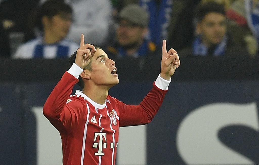 Bayern's James Rodriguez celebrates after scoring during the German Bundesliga soccer match between FC Schalke 04 and Bayern Munich at the Arena in Ge...