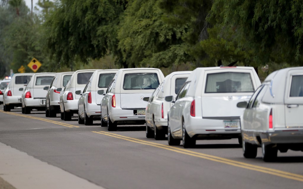 FILE - In this July 25, 2017 file photo, hearses carrying family members who were killed in a flash flood leave St. Patrick Catholic Church, Tuesday, ...