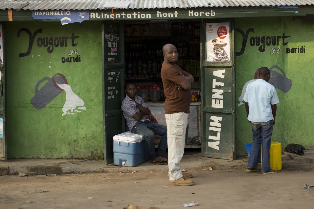 In this photo taken Aug. 10, 2016, a man stands at the entrance of a shop in the Congo Ituri province capital Bunia. By virtue of being the largest U....