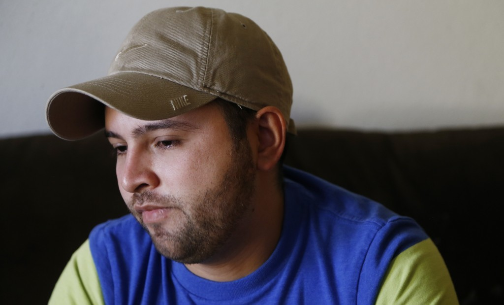 Cesar Garcia pauses for a moment as he talks about how he and other family members survived the Payson, Ariz., flash flooding this summer that killed ...