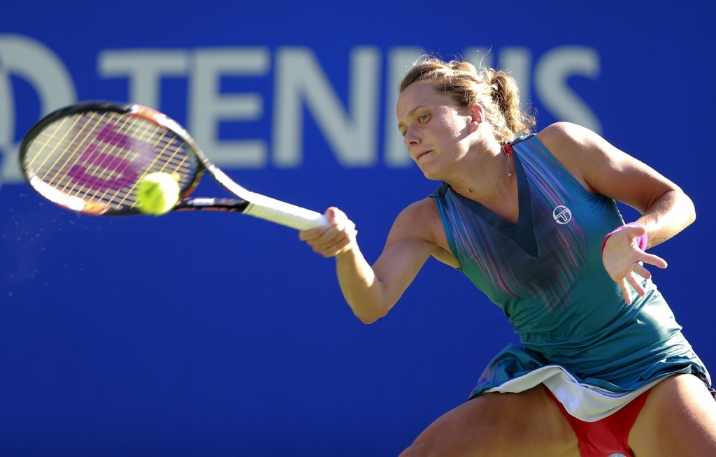 Barbora Strycova of the Czech Republic returns a shot to Johanna Konta of Britain during their second round match of the Pan Pacific Open tennis tourn...