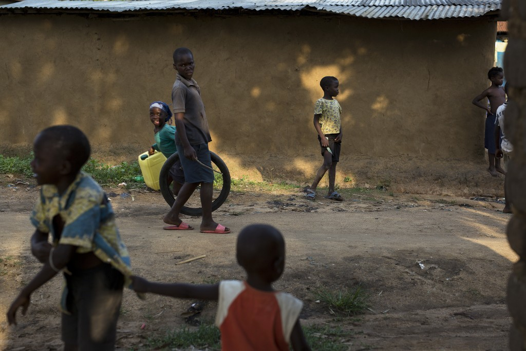 In this photo taken Aug. 10, 2016, children play in the Congo Ituri province capital Bunia. By virtue of being the largest U.N. peacekeeping mission, ...