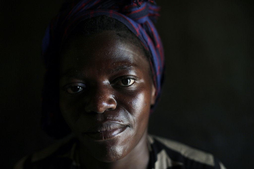 In this photo taken Aug. 10, 2016, Blandine poses for a portrait in the Congo Ituri province capital Bunia. Blandine said she was raped at age 15 by a...