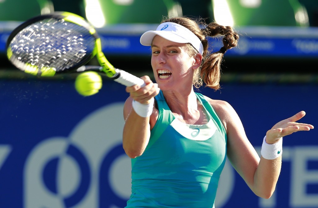 Johanna Konta of Britain returns a shot to Barbora Strycova of the Czech Republic during their second round match of the Pan Pacific Open tennis tourn...