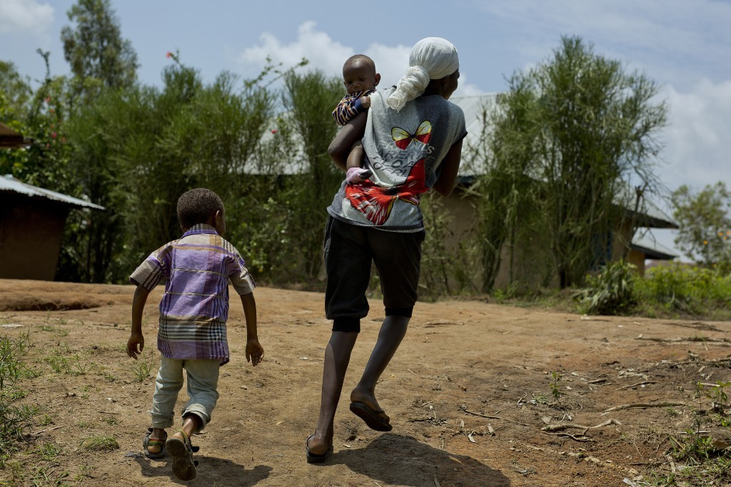 In this photo taken Aug. 10, 2016, 8-year-old Michael, left, runs after his mother Blandine in the Congo Ituri province capital Bunia. Blandine said M...