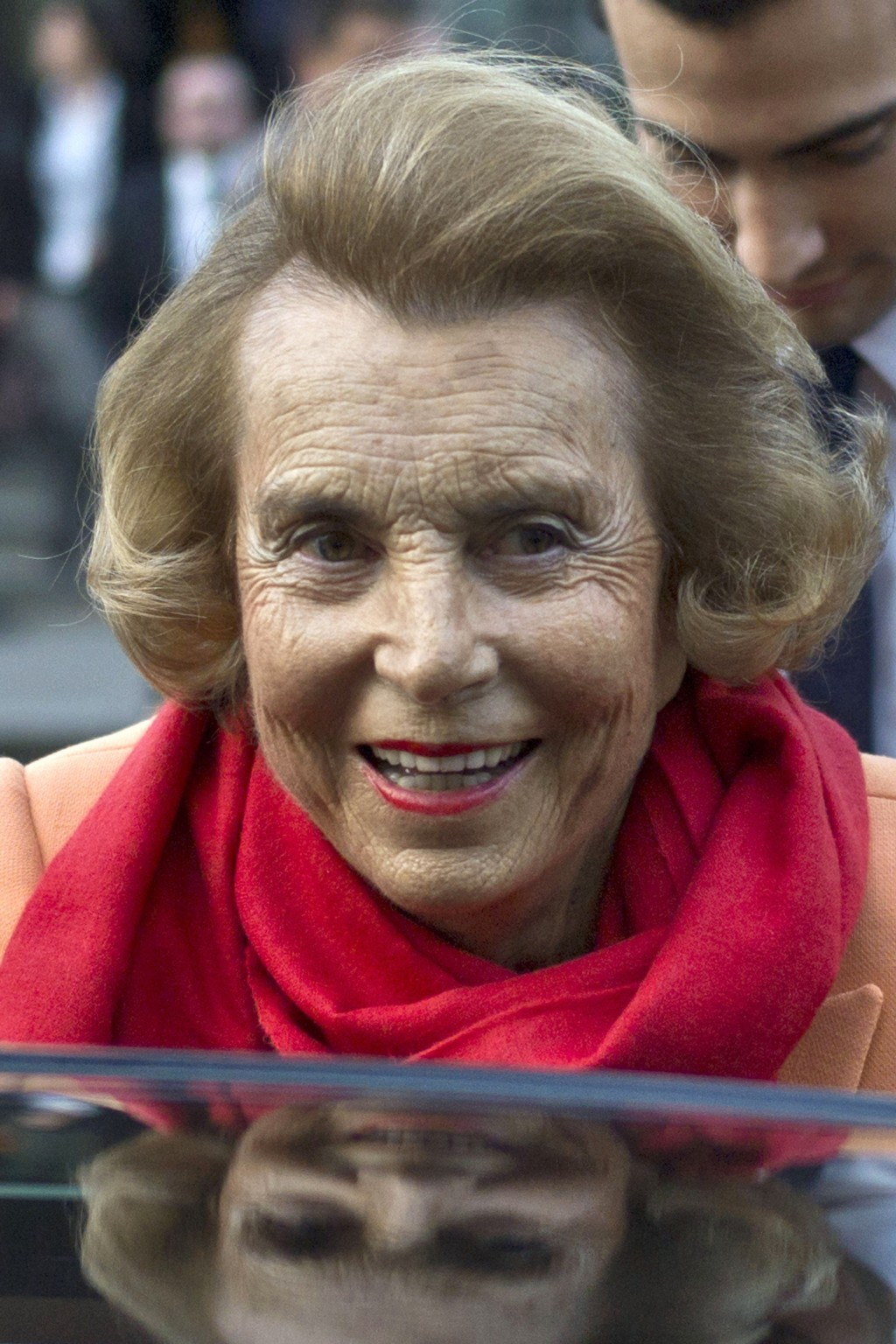 FILE - In this March 29, 2012 file photo, L'Oreal heiress Liliane Bettencourt leaves the L'Oreal-UNESCO prize for the women in science, in Paris, Fran...