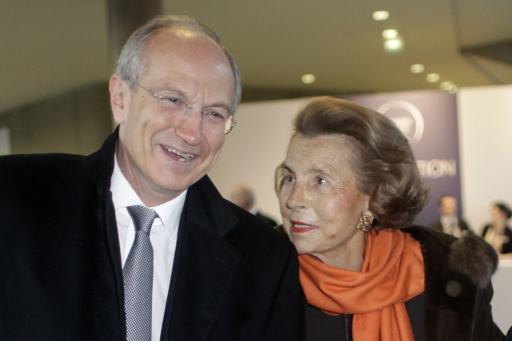 FILE - In this Thursday March 3, 2011 file photo, L'Oreal heiress Liliane Bettencourt, right, and L'Oreal new chief executive Jean-Paul Agon arrive at...