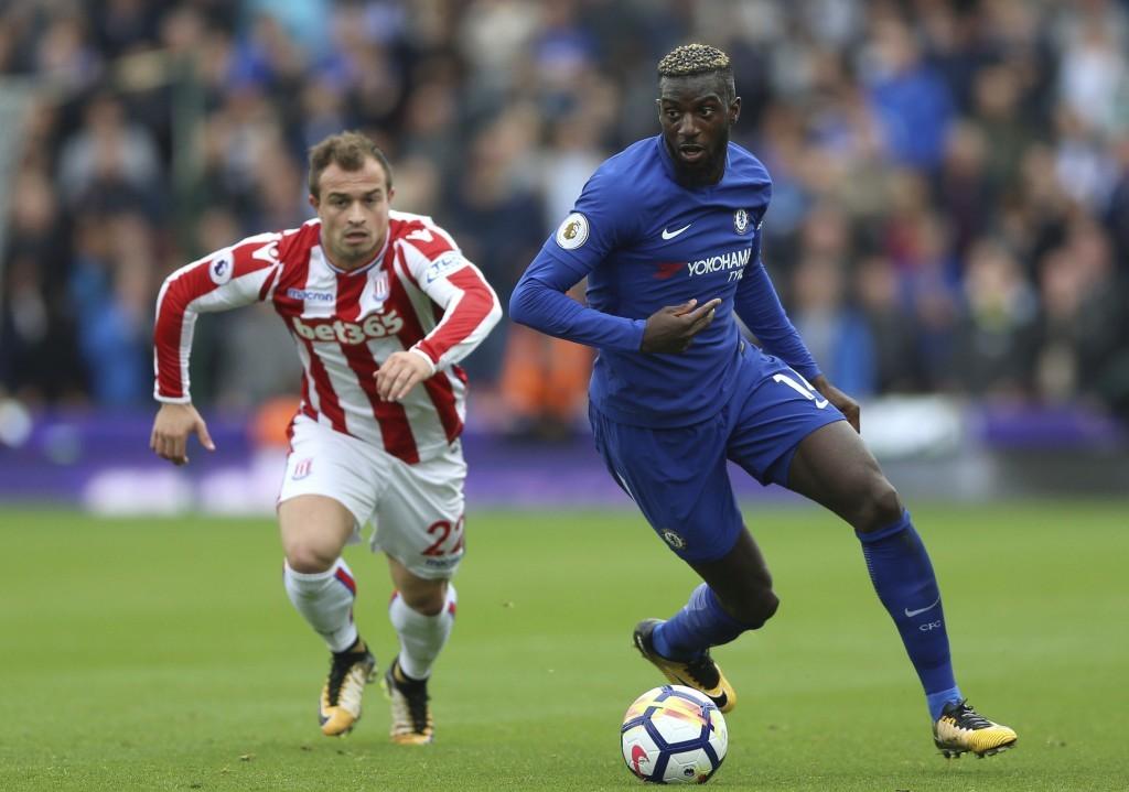 Chelsea's Tiemoue Bakayoko, right, gets away from Stoke City's Xherdan Shaqiri  during the English Premier League soccer match between Stoke City and ...