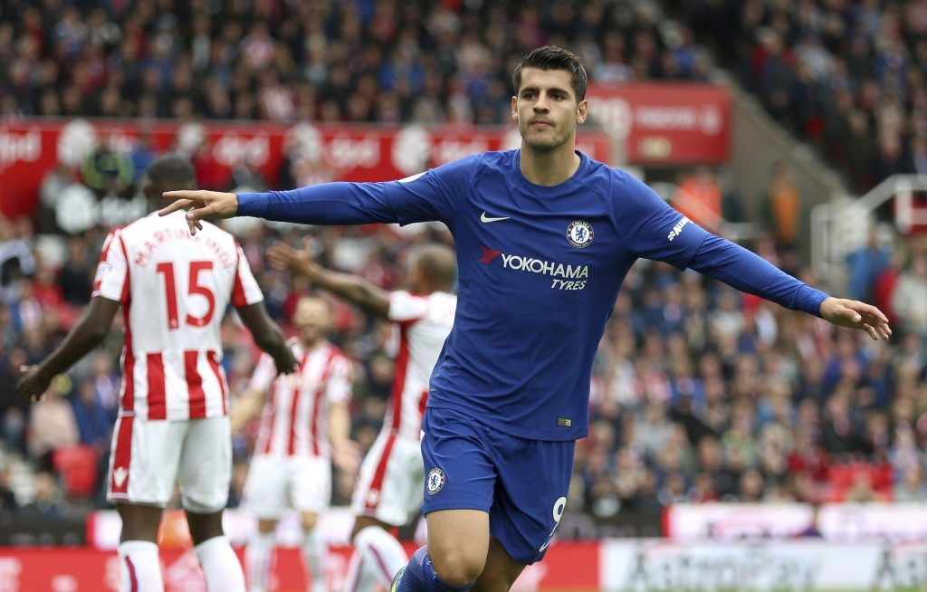 Chelsea's Alvaro Morata celebrates scoring his side's first goal of the game during the English Premier League soccer match between Stoke City and Che...